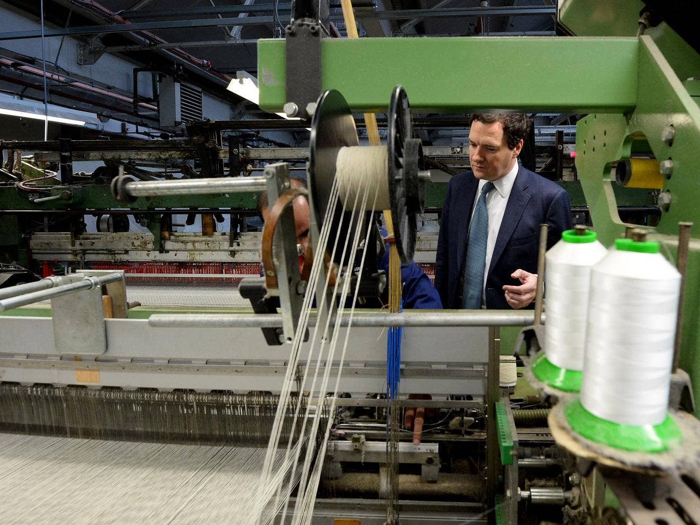 George Osborne during a visit to AW Hainsworth and Sons textile manufacturer in October. Year-on-year growth in GDP is expected to be 2.8 per cent in the fourth quarter of 2013, up from 1.9 per cent in the third