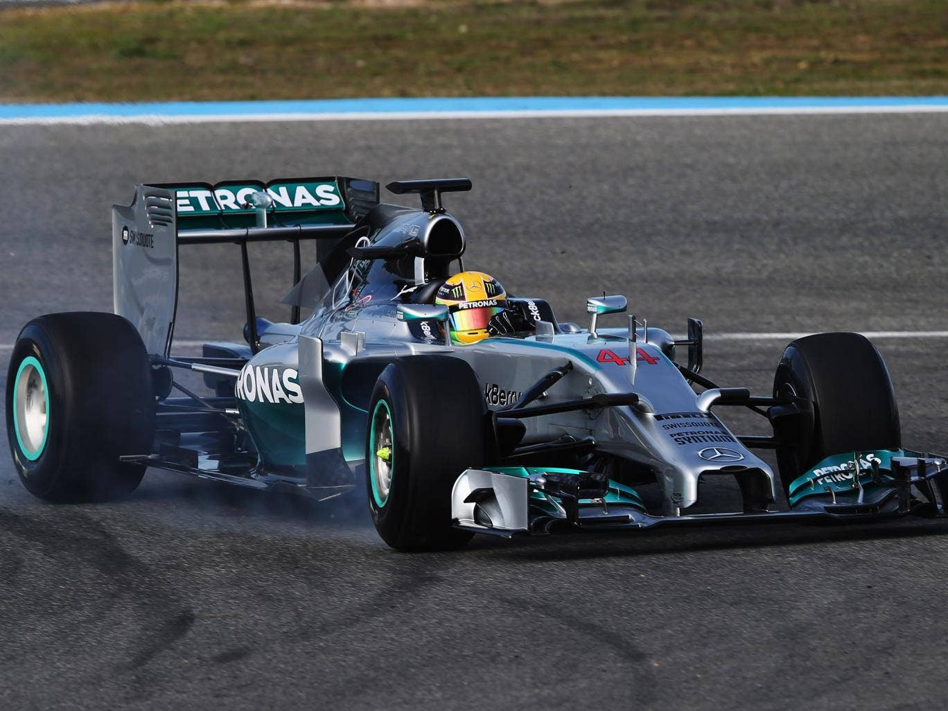 Lewis Hamilton suffered a front wing failure on the first day of testing in Jerez that caused him to plow into the tyre barrier