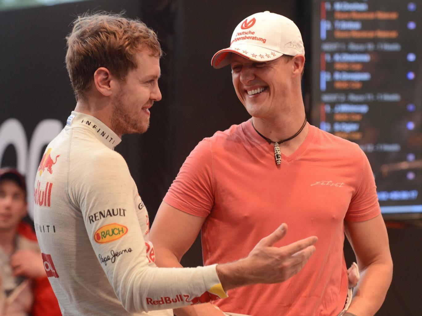 Sebastian Vettel and Michael Schumacher share a joke during the 2012 Race of Champions in Bangkok