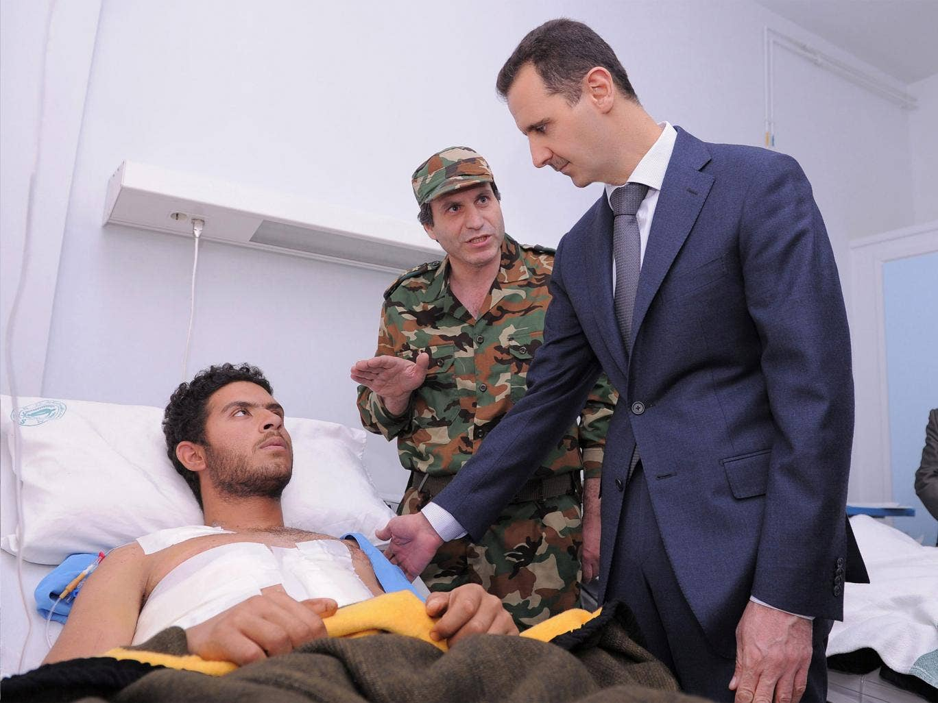 Syrian President Bashar Assad visits army and security soldiers wounded in the civil war at al-Youssef al-Azmah Hospital in Damascus