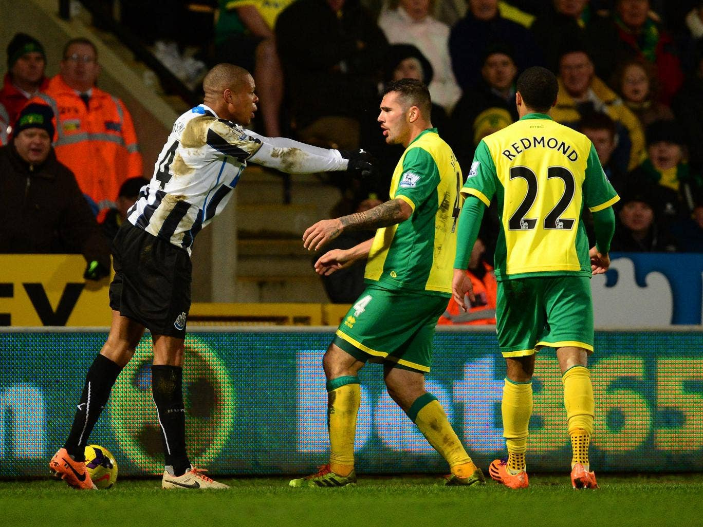 Loic Remy of Newcastle United and Bradley Johnson of Norwich City come to blows