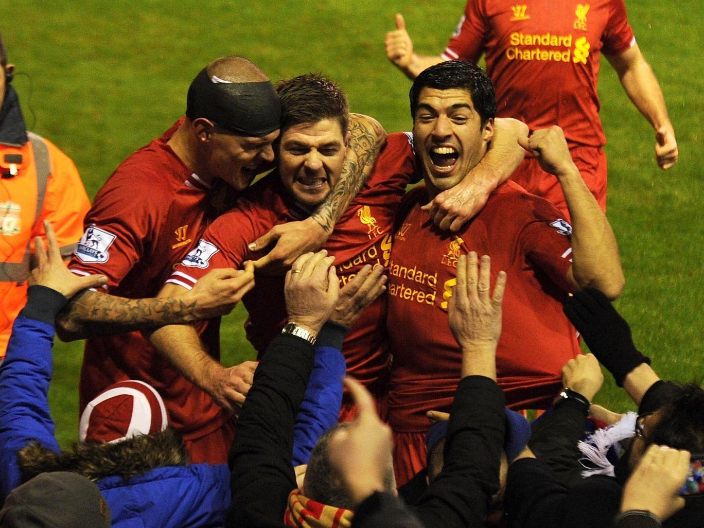 Steven Gerrard of Liverpool celebrates his goal with Martin Skrtel and Luis Suarez