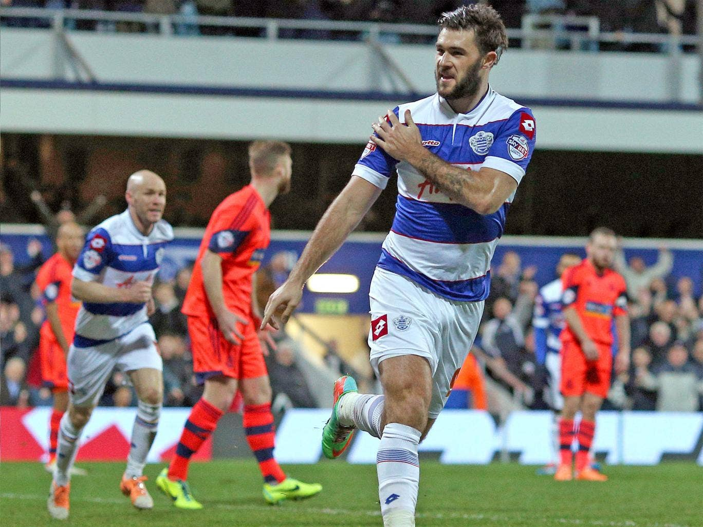 QPR's Charlie Austin celebrates scoring the opener in the 2-0 win over Bolton