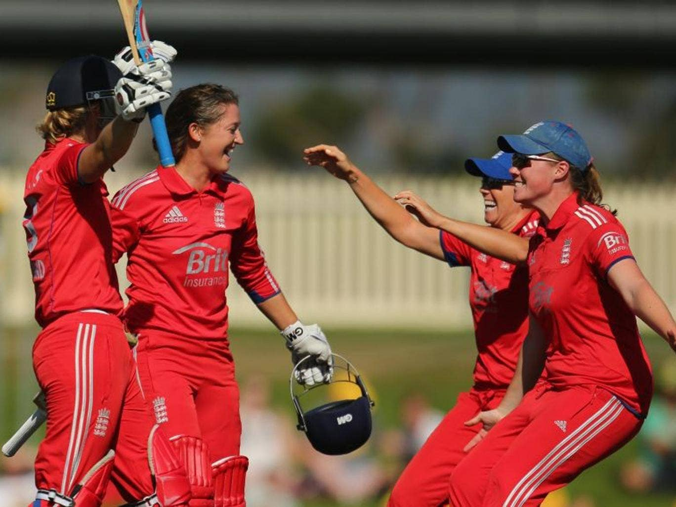 Sarah Taylor and Charlotte Edwards celebrate with teammates after winning the match and retaining the Ashes in Hobart