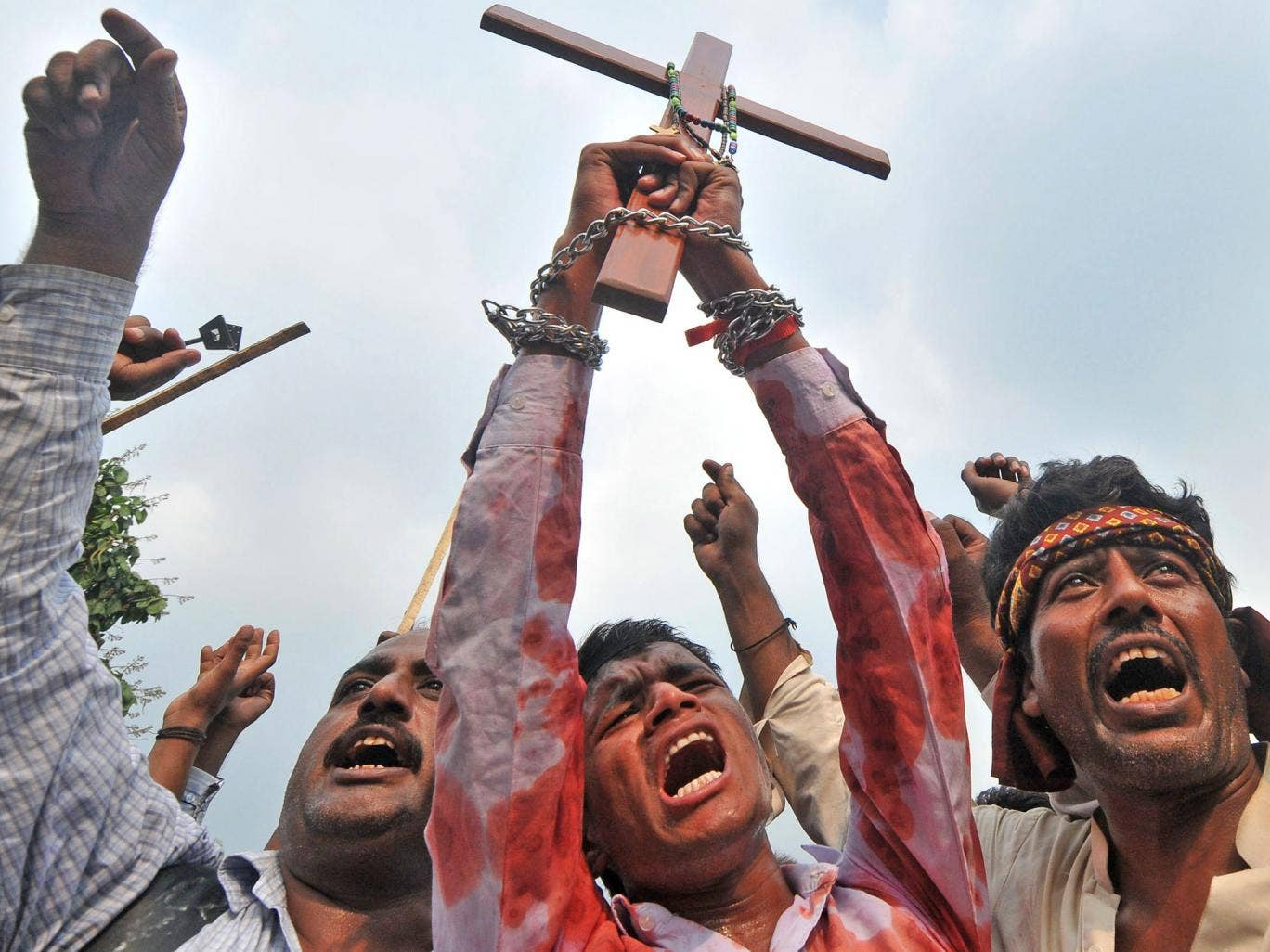 Cross to bear: Pakistani Christians protest in Lahore after the suicide bombing of a church in Peshawar