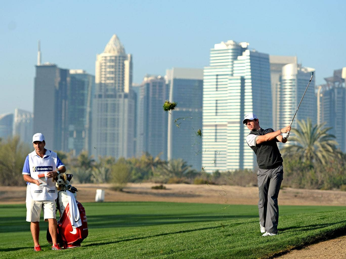 Rory McIlroy plays a shot on the 13th during the pro-am event ahead of the Dubai Desert Classic