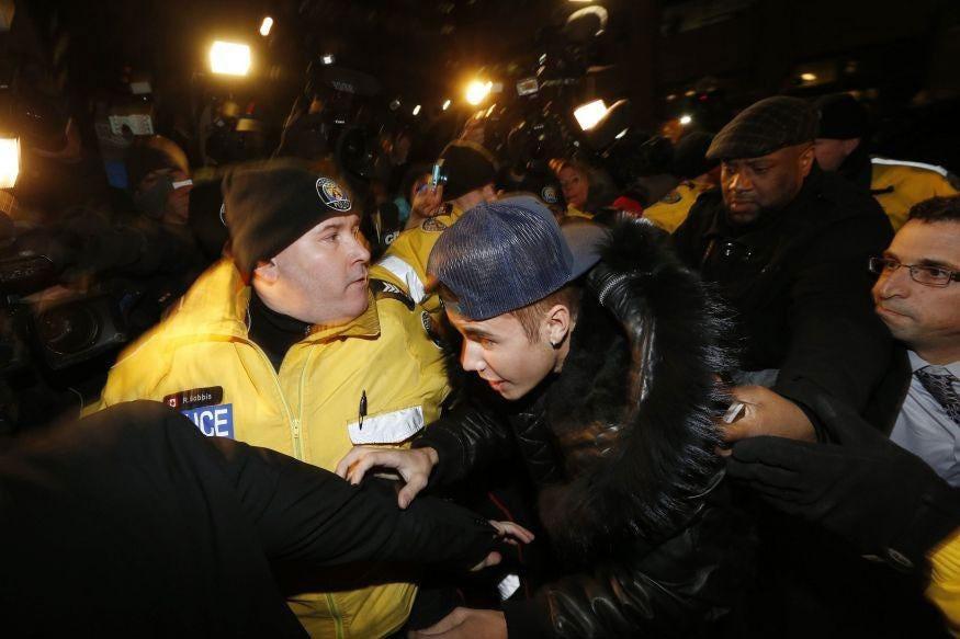 Justin Bieber arrives at a police station in Toronto
