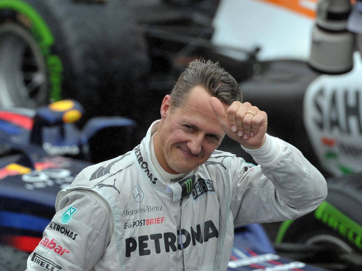 Michael Schumacher gives the thumbs up after qualifying first in Monaco