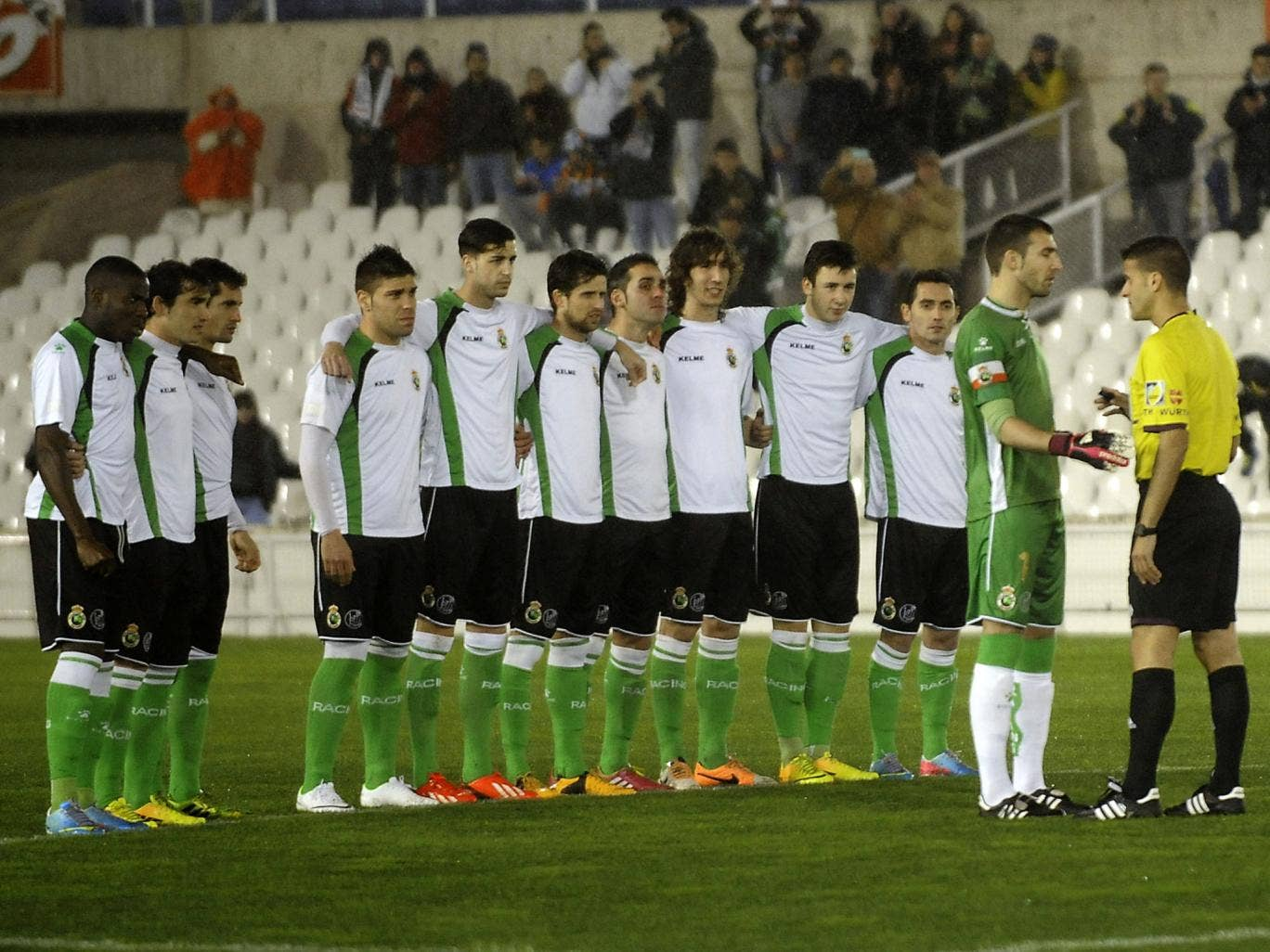 Racing Santander speak to the referee after refusing to contest their Copa del Rey quarter-final due to unpaid wages