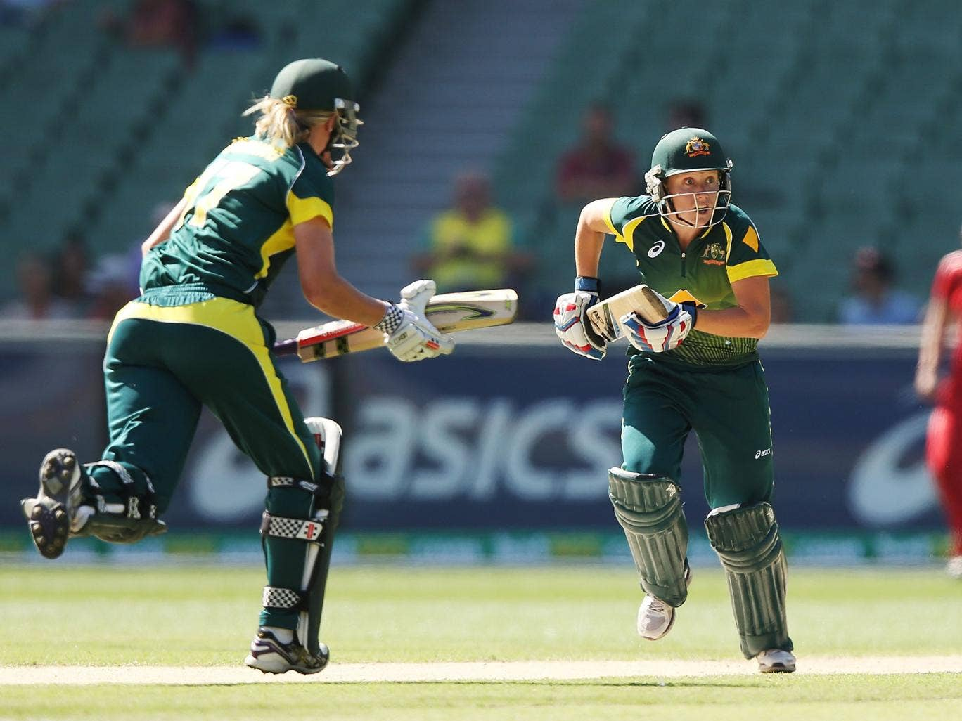 Alyssa Healy (R) of Australia runs between wickets during game two of the International Twenty20 series between Australia and England at the MCC