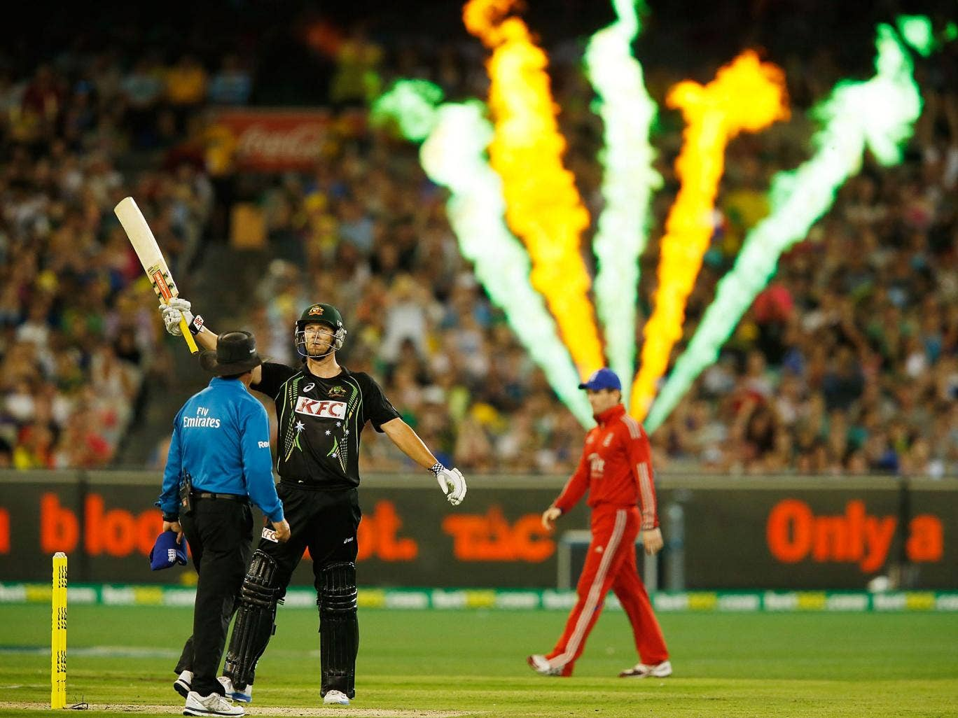 Cameron White of Australia raises his bat after reaching 50 runs during game two of the International Twenty20 series between Australia and England