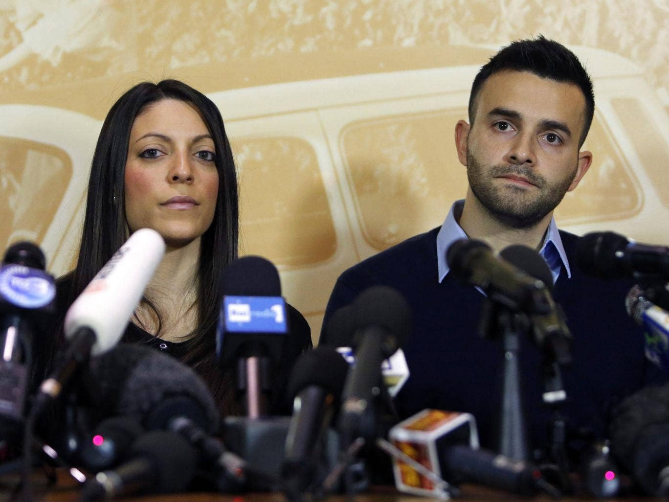 Stephanie Kercher (L) and Lyle Kercher, the sister and brother of murdered British student Meredith Kercher, attend a news conference in Florence