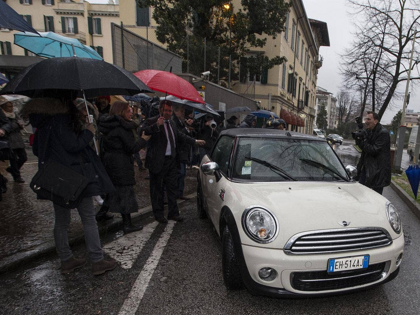 Raffaele Sollecito leaving the police station in the north-eastern town of Udine on Friday after surrendering his passport