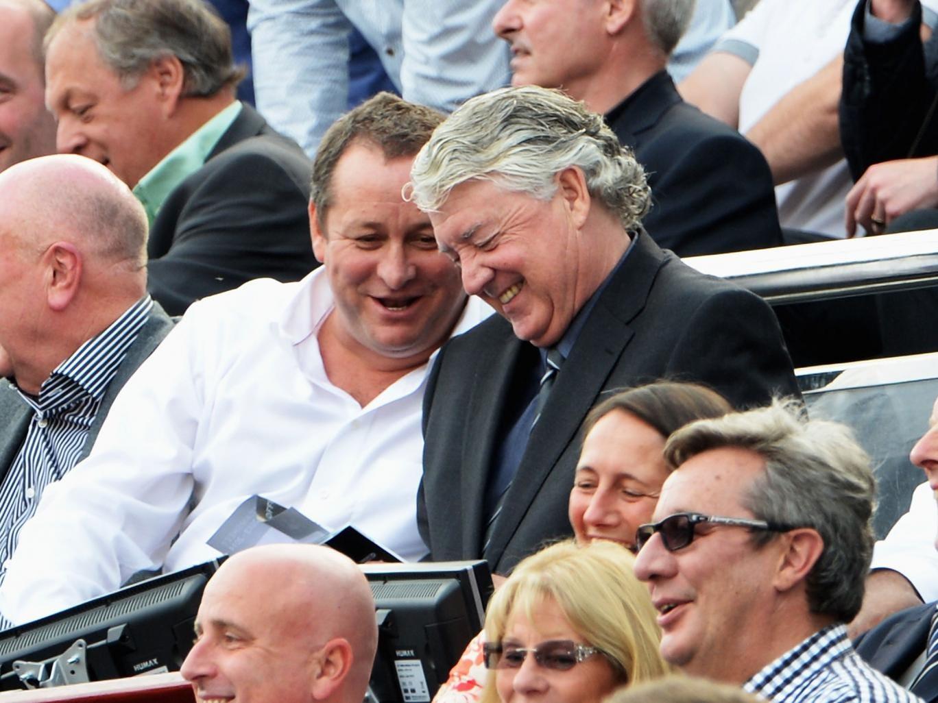 Mike Ashley and Joe Kinnear enjoy their seats at the heart of St James's Park