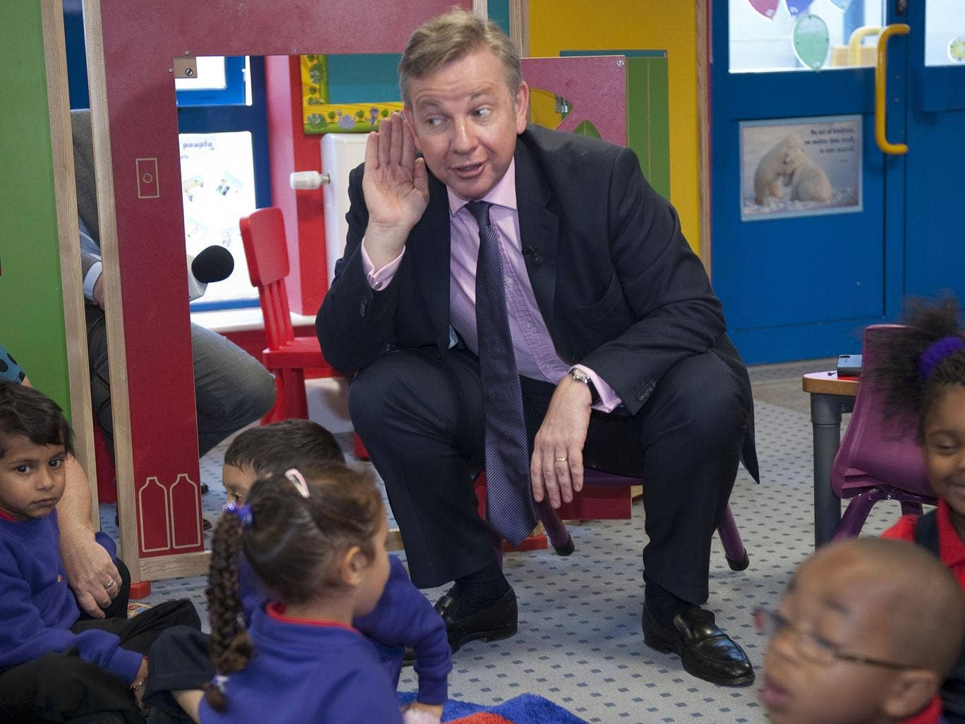 Michael Gove visits a primary school in 2011; four-year-olds will take tests upon entering the reception year