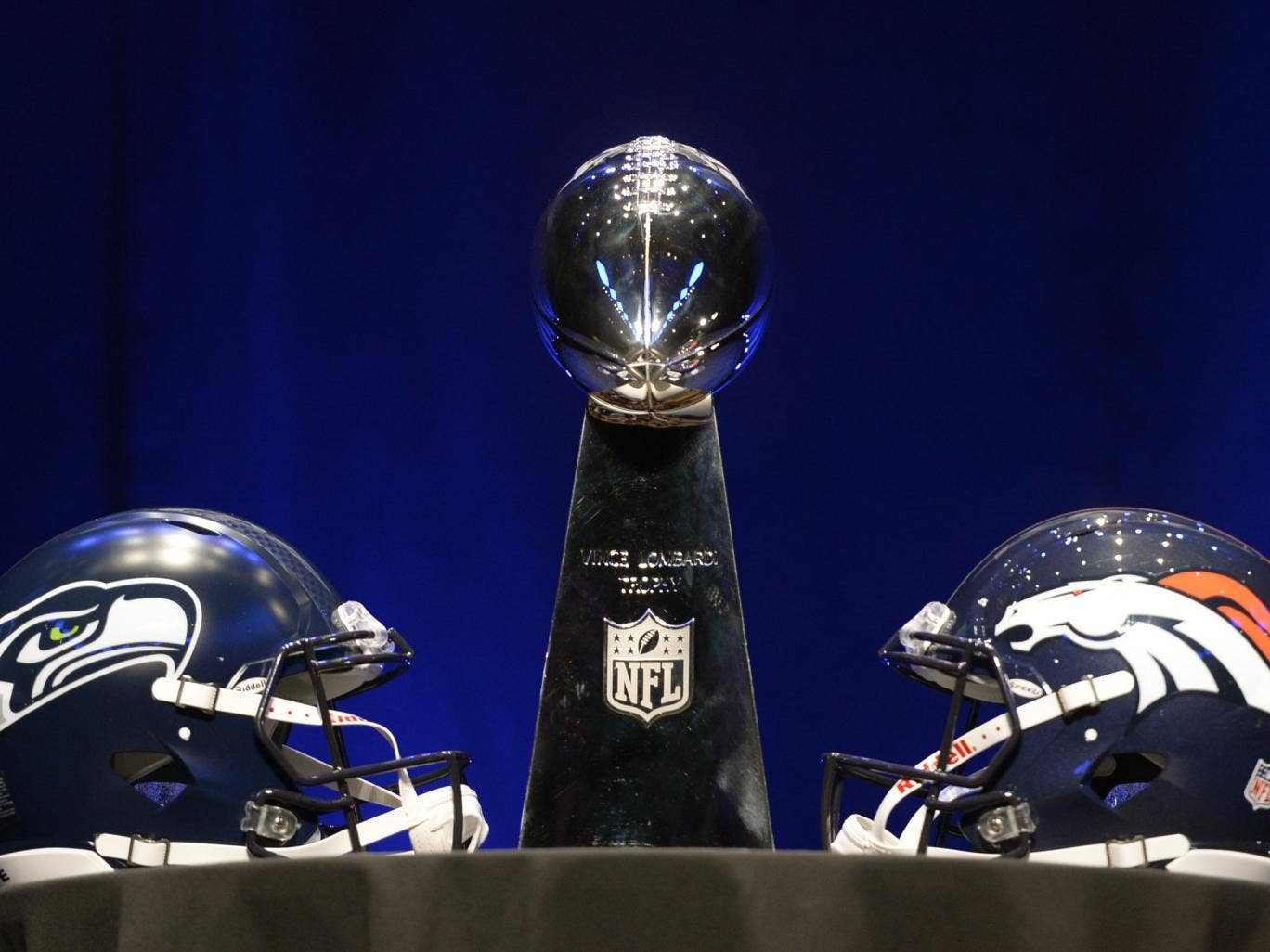 The Vince Lombardi Trophy and helmets for the Denver Broncos(R) and the Seattle Seahawks