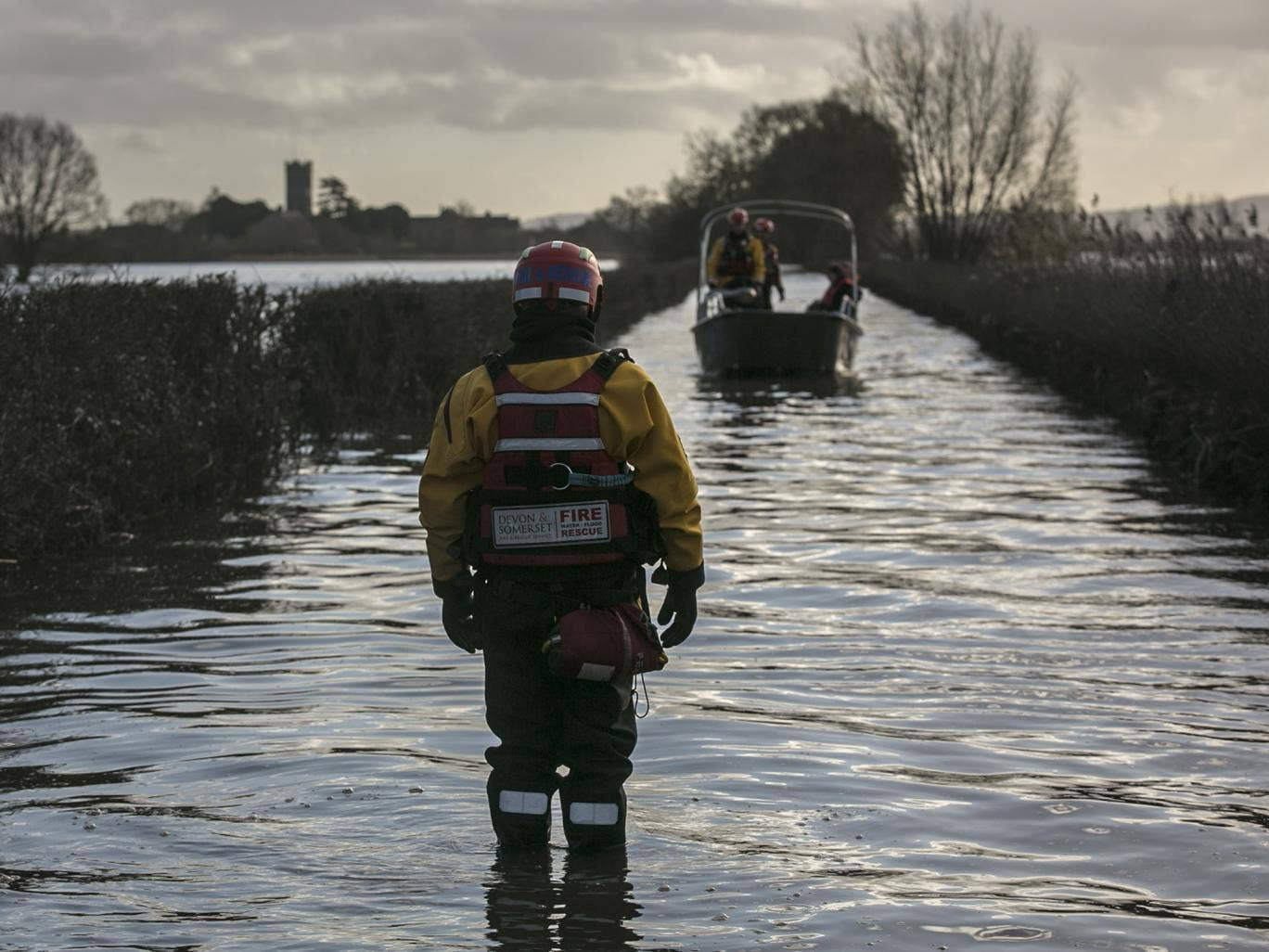 The humanitarian support boat operated by a crew from Devon and Somerset Fire and Rescue Service arrives from Muchelney, a village still cut off by flood water near Langport in Somerset