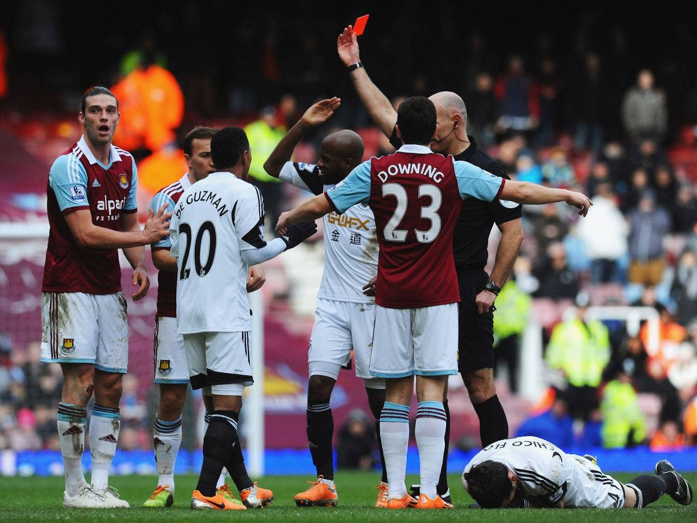 West Ham striker Andy Carroll is shown a red card