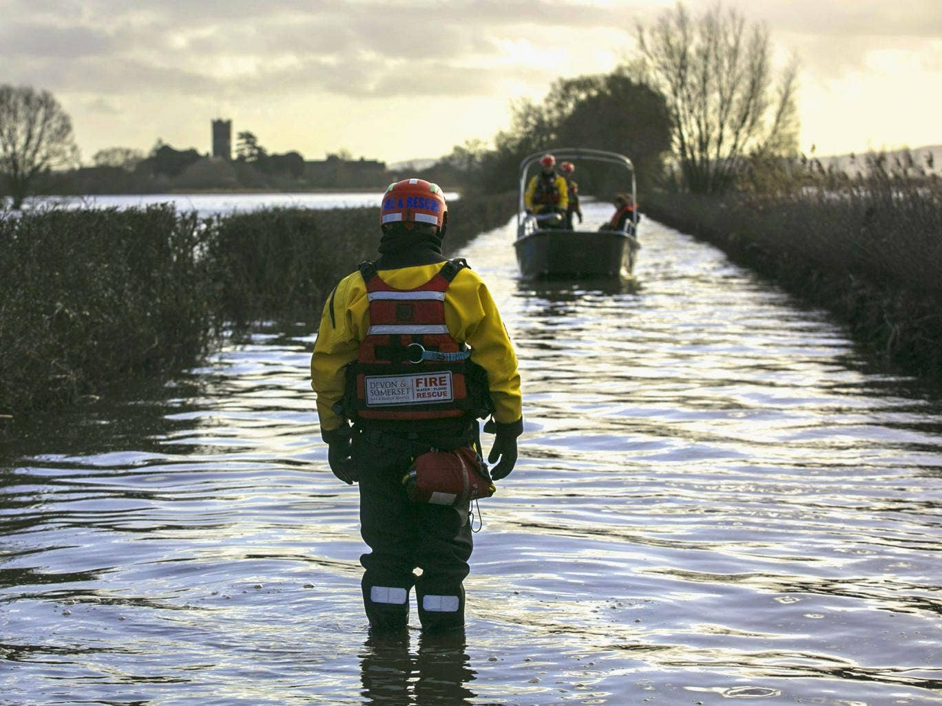 The humanitarian support boat operated by a crew from Devon and Somerset Fire and Rescue Service arrives from Muchelney, a village near Langport in Somerset still cut off by flood water