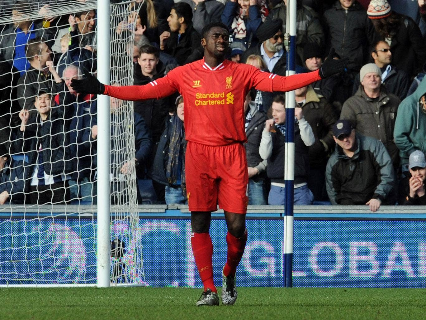 Kolo Toure shows his frustration with himself after giving the ball away to Victor Anichebe with the West Brom striker going on to score their equaliser
