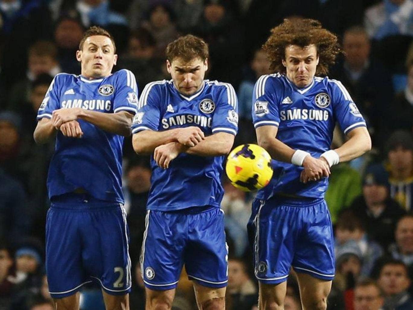 From left: Chelsea's Nemanja Matic, goalscorer Branislav Ivanovic and David Luiz show the collective spirit that led their side to victory over Manchester City last night