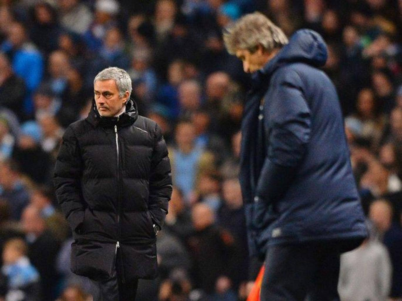 Joe Mourinho (left) got his tactics at the Etihad Stadium spot on while Manuel Pellegrini suffered a setback