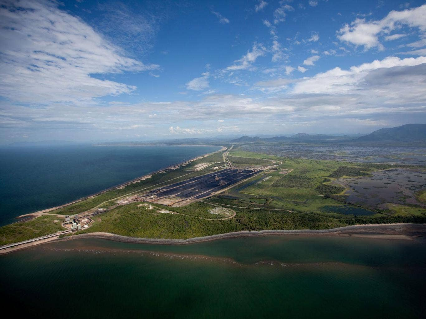 A picture made available by Greenpeace shows an aerial view of the Abbot Point coal point, where controversial plans to dump sludge in Great Barrier Reef Marine Park waters have been approved