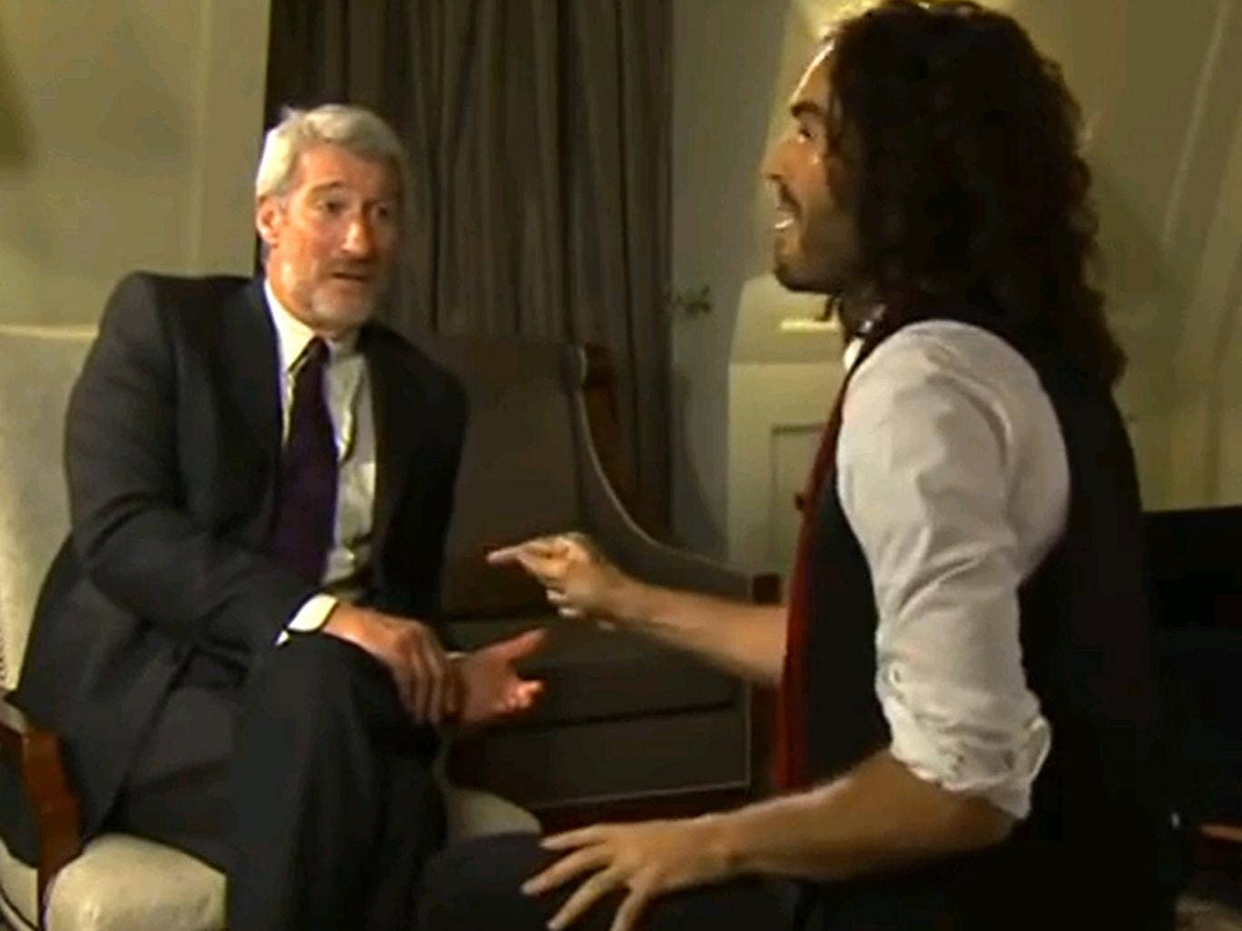 Russell Brand (right) with Jeremy Paxman on 'Newsnight', in which he confessed that he had never voted