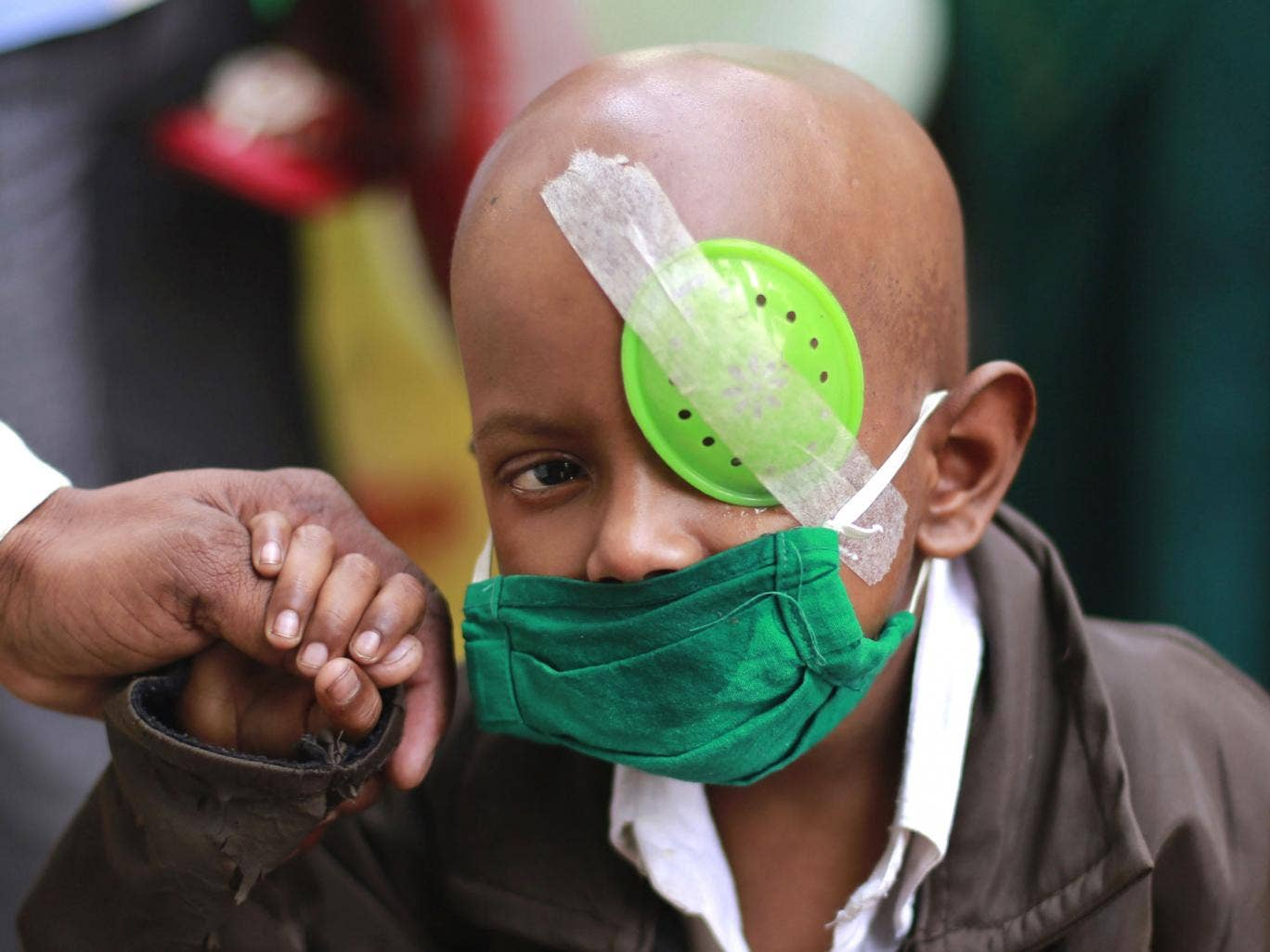 A child suffering from cancer leaves the Tata Memorial cancer treatment and research center on World Cancer Day in Mumbai