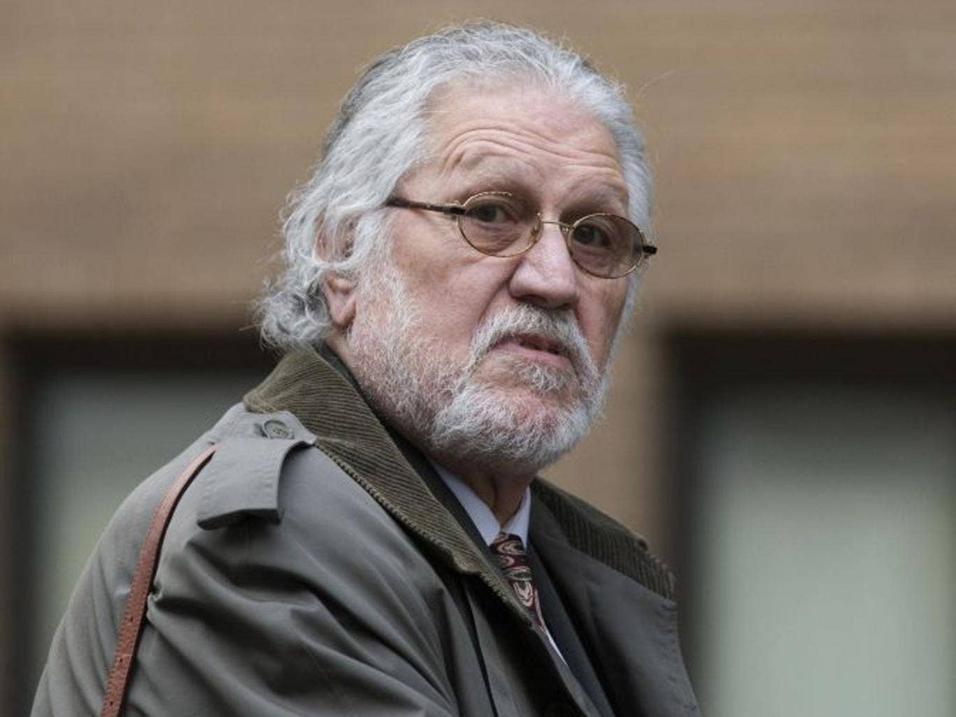 Radio presenter Dave Lee Travis arrives at Southwark Crown Court on 5 February 2014