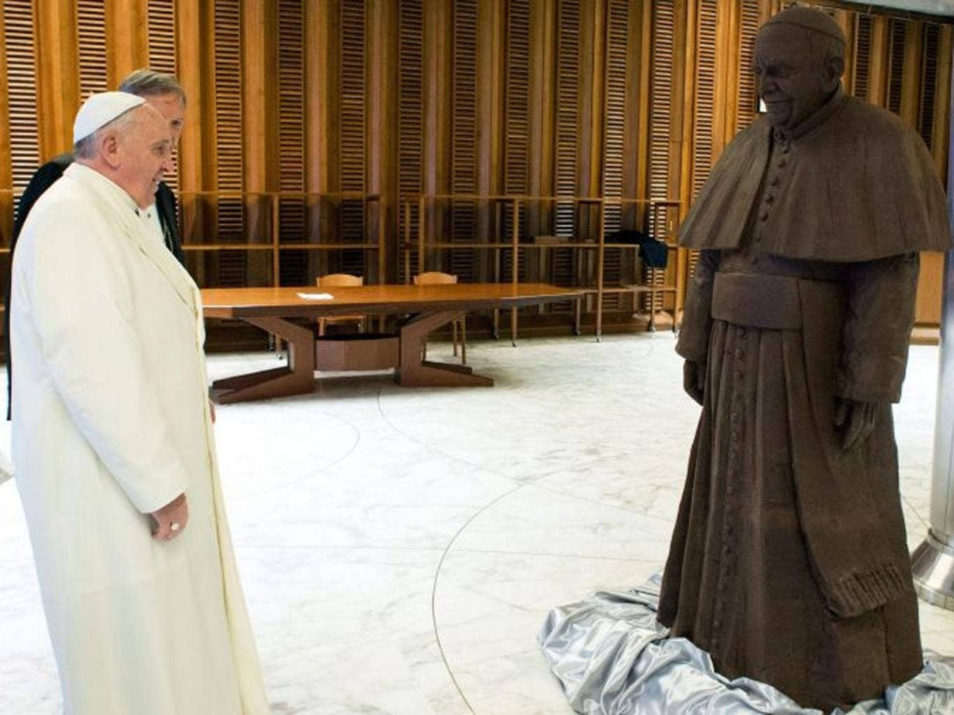 Pope Francis stands in front of a chocolate statue of him in Vatican City, Vatican, 05 February.