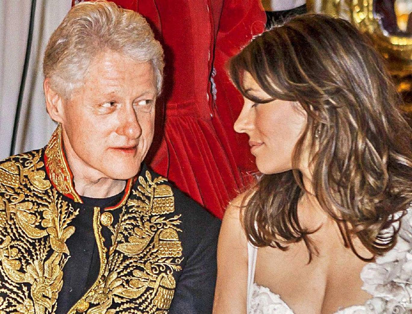 Coming to the braid of the party: Bill Clinton and Elizabeth Hurley in St Petersburg in 2005