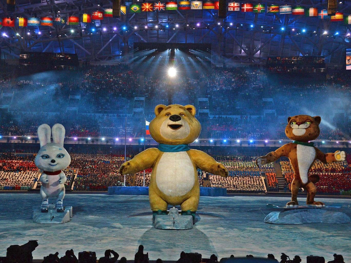 The Winter Olympic mascots the Hare, the Polar Bear and the Leopard loom large above the arena