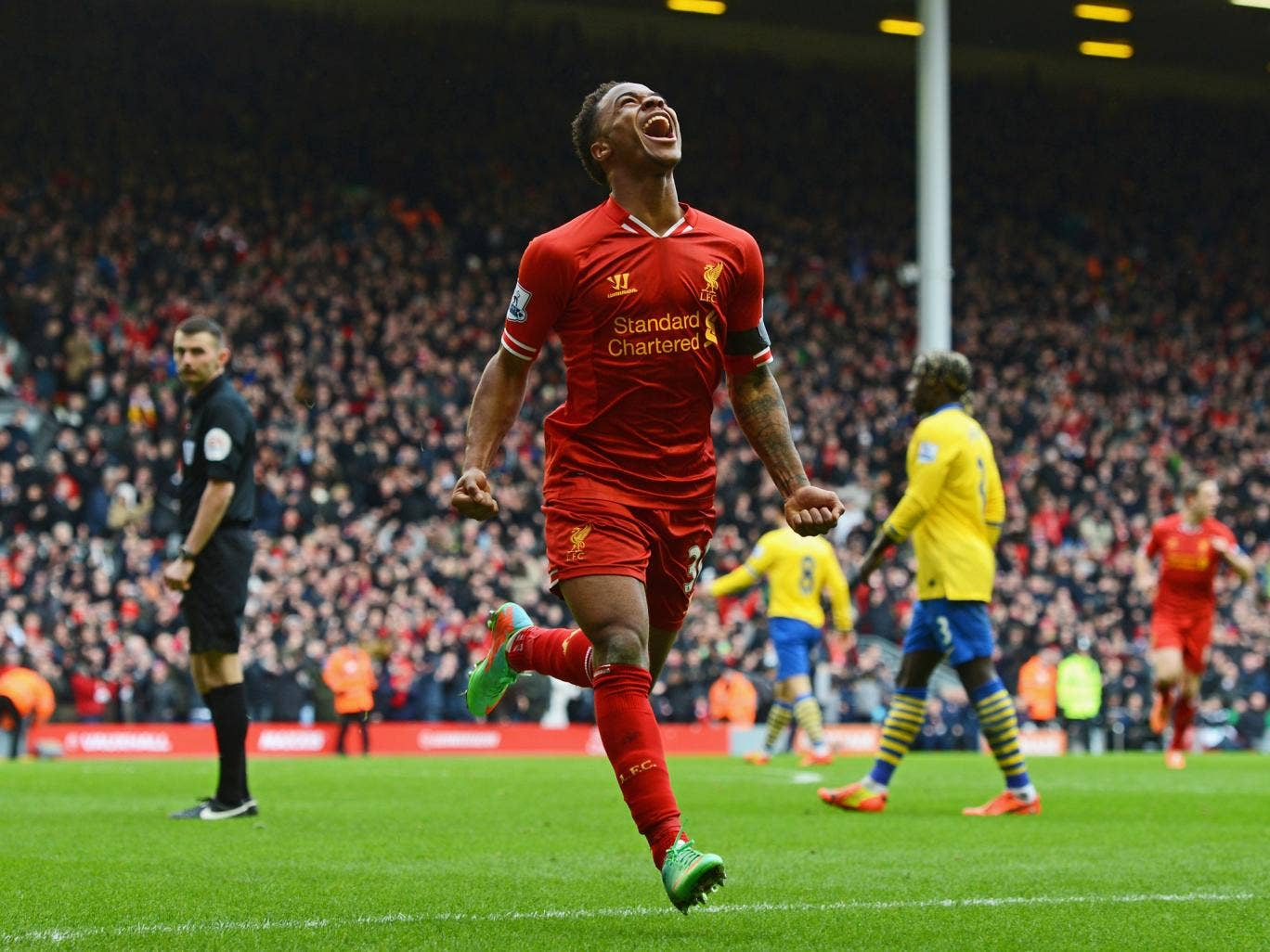Raheem Sterling celebrates scoring in the victory over Arsenal for Liverpool