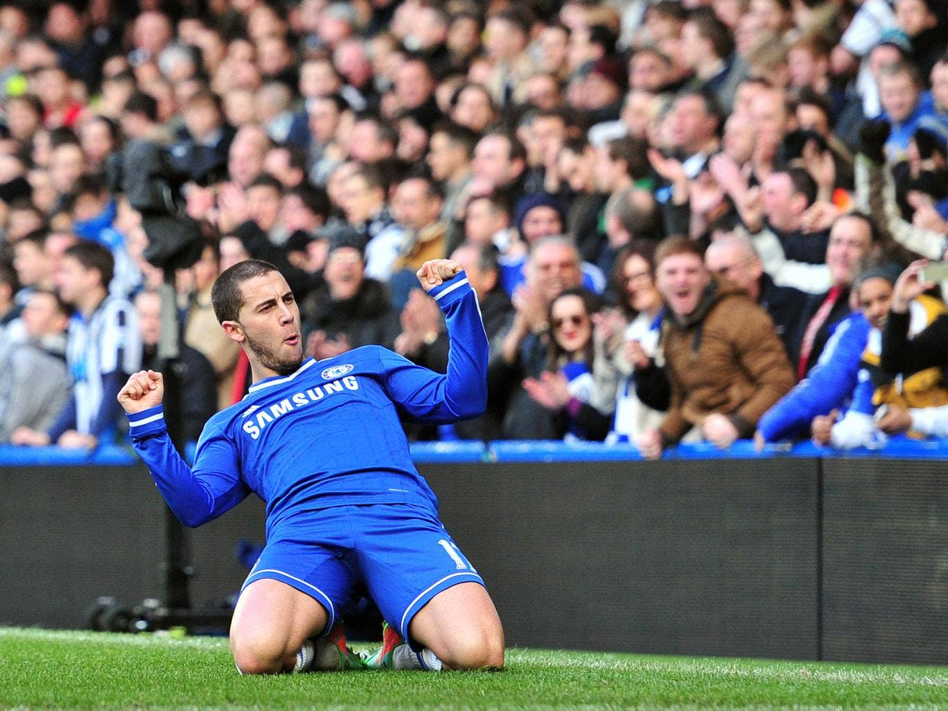 Eden Hazard celebrates his hat-trick for Chelsea in the win over Newcastle