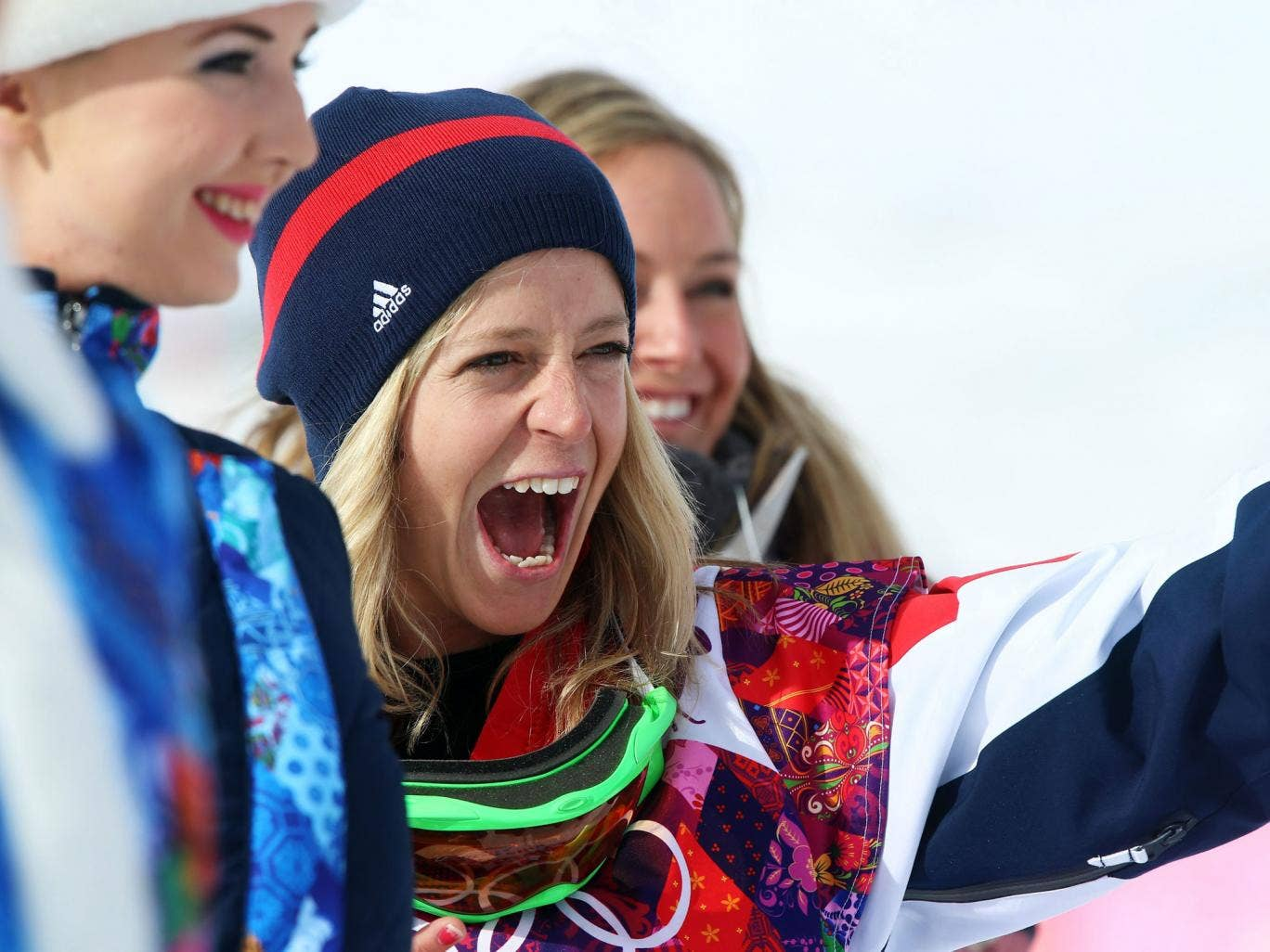 Jenny Jones of Great Britain celebrates an historic bronze on the snow after the flower ceremony of the Women's Snowboard Slopestyle final at Rosa Khutor Extreme Park at the Sochi 2014 Olympic Games, 9 February 2014