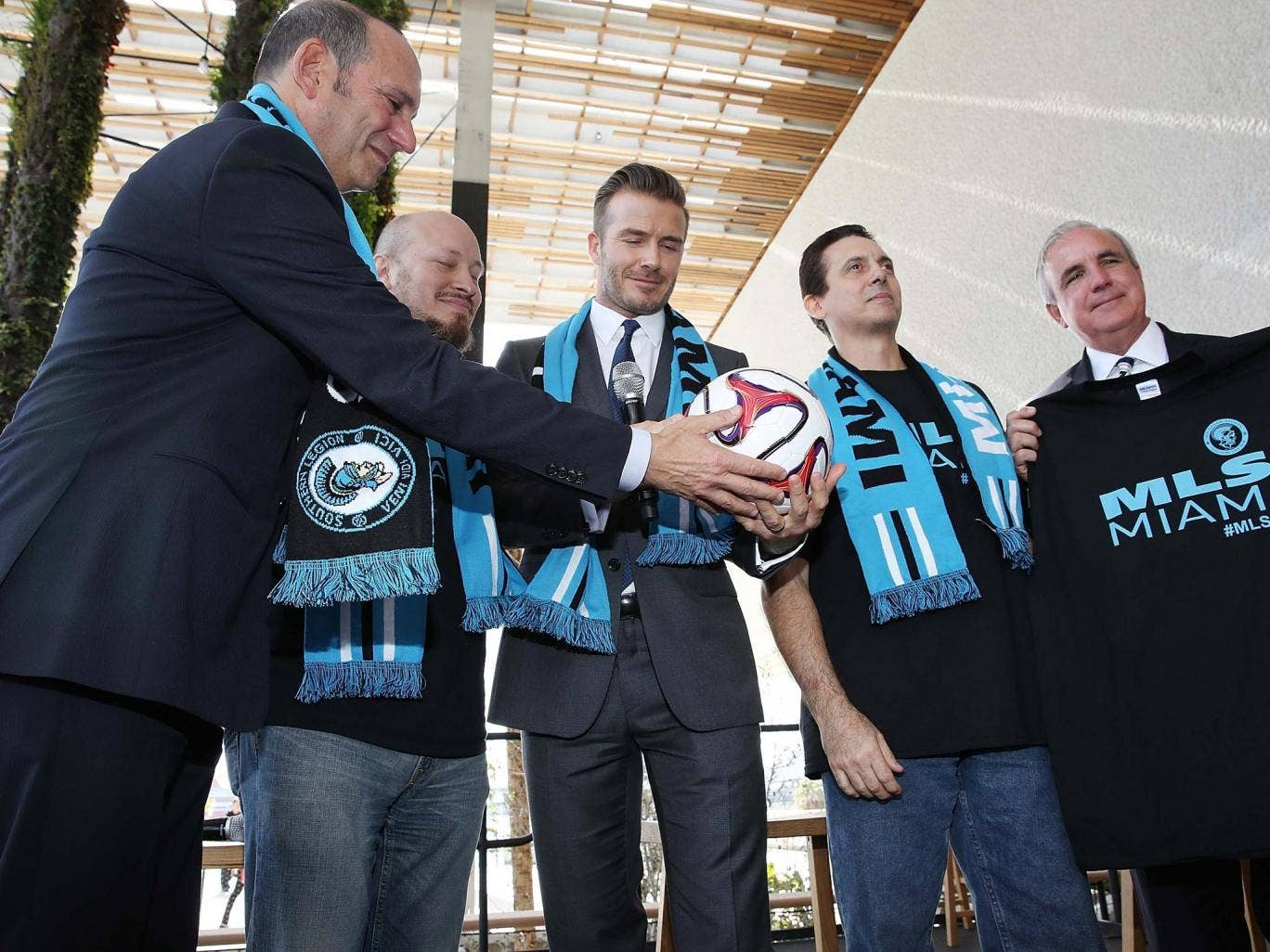 Beckham (centre) at his Miami press conference to launch plans for a new MLS franchise
