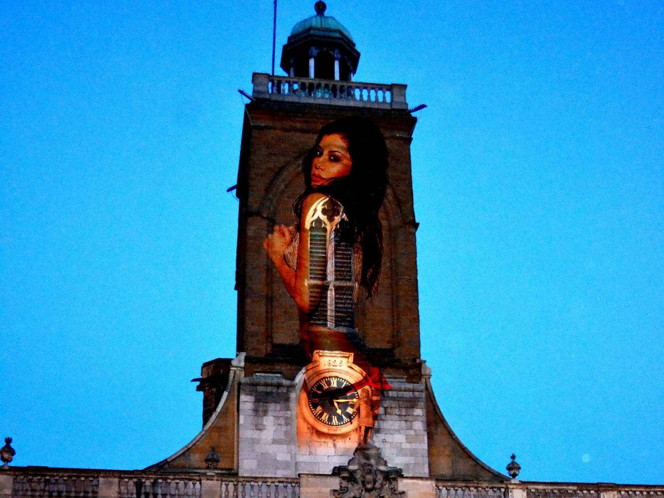 The casino which carried out the stunt said it 'meant no offence' by the promotion, which saw a 30ft semi-naked model projected onto the church tower at All Saints', Northampton