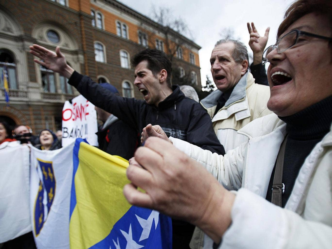 Anti-government protesters protest in front of the Presidency building in Sarajevo