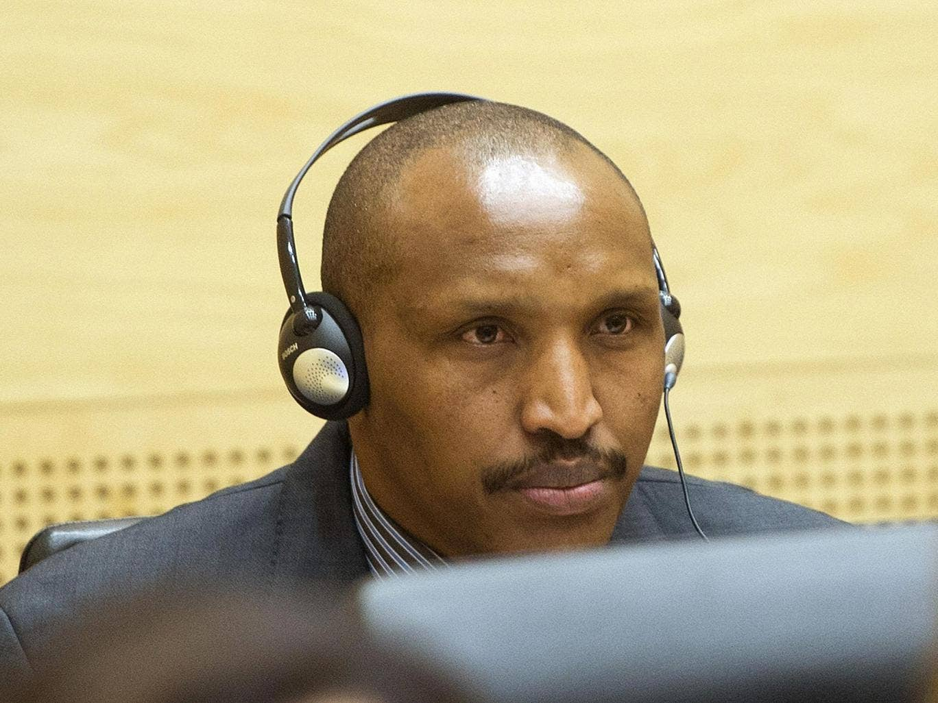 Congolese militia leader Bosco Ntaganda appears at the International Criminal Court charged with war crimes and crimes against humanity in a hearing in The Hague