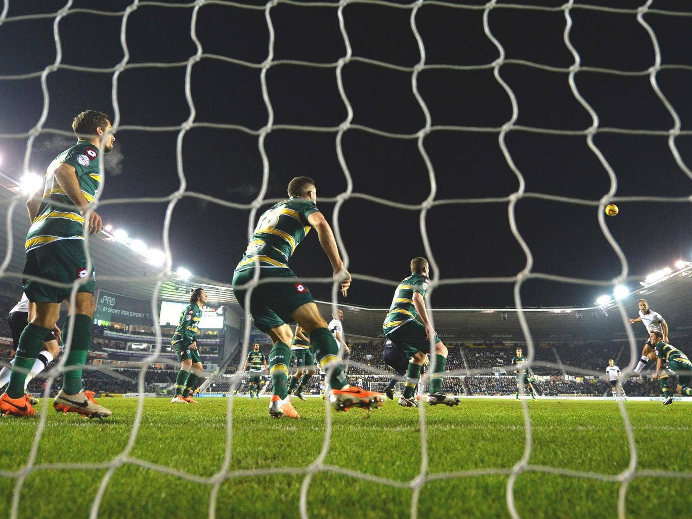 John Eustace of  Derby County heads home the opening goal during the Sky Bet Championship match between Derby County and Queens Park Rangers