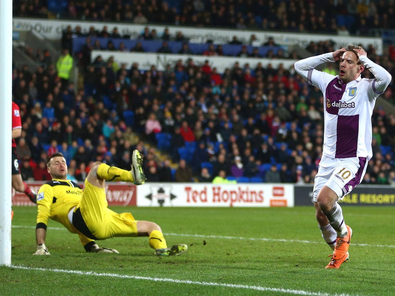 Cardiff's David Marshall makes a last minute save from Andreas Weimann
