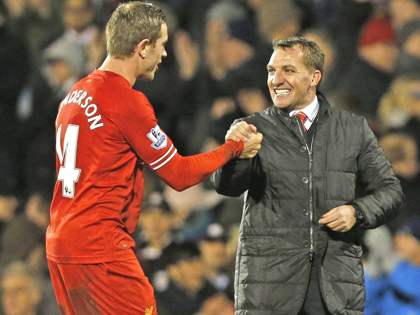 Liverpool manager Brendan Rodgers shares the joy of a hard-fought victory with midfielder Jordan Henderson