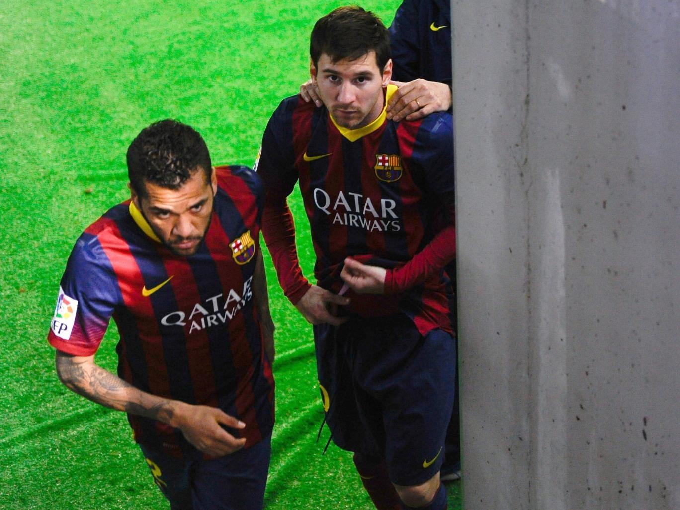 Lionel Messi and his teammate Dani Alves of FC Barcelona leave the locker room area prior to the Copa del Rey semi final second leg against Real Sociedad