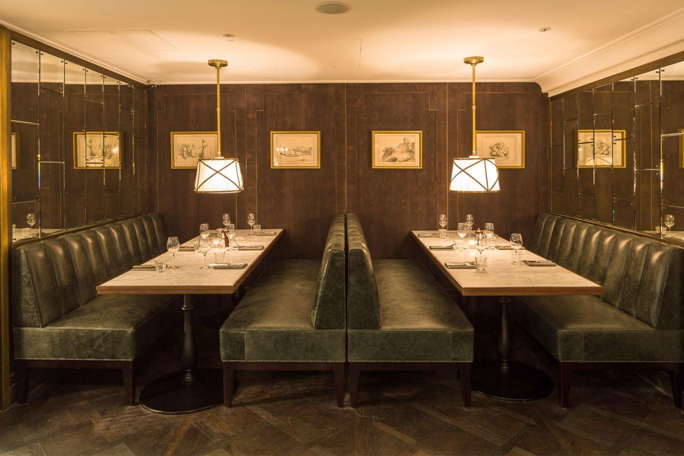 Clubbishly attractive: The restaurant's small, dark dining room has been de-blinged