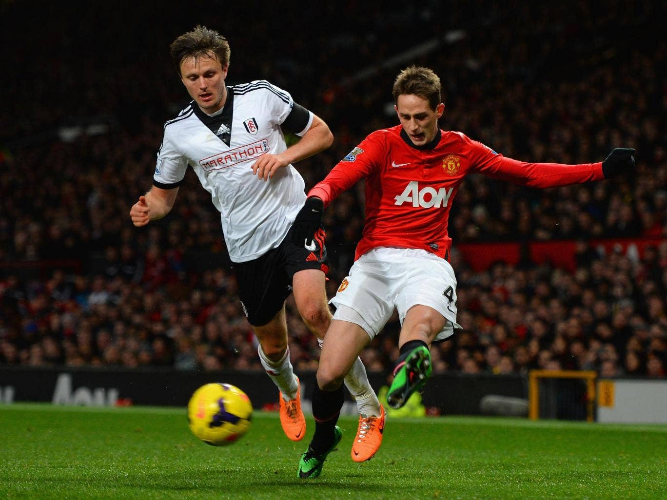 William Kvist of Fulham competes with Adnan Januzaj (right) of Manchester United