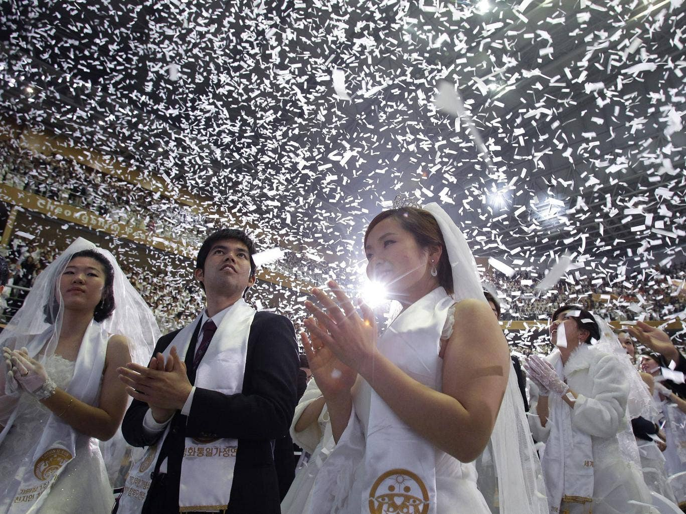 Couples take part in a mass wedding ceremony at Cheongshim Peace World Center in Gapyeong-gun