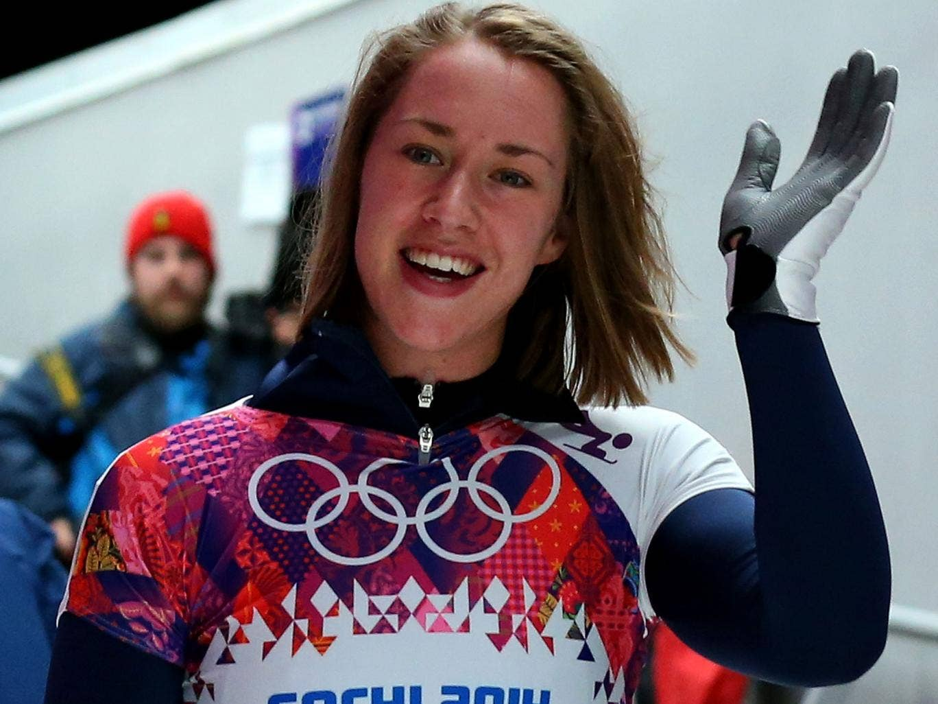 Lizzy Yarnold of Great Britain waves to fans after competing her third run during the Women's Skeleton today