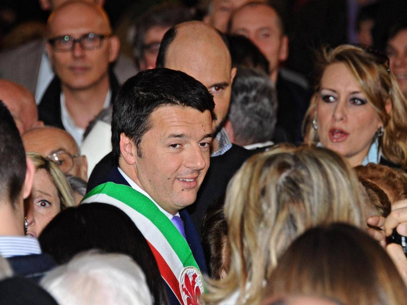 Democratic Party (PD) leader and Florence Mayor, Matteo Renzi (centre) smiles during a ceremony at the Palazzo Vecchio in Florence