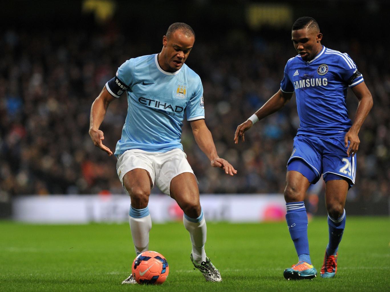 Vincent Kompany protects the ball from Chelsea striker Samuel Eto'o